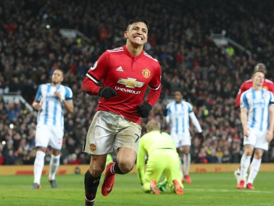 Manchester United 2 - 0 Huddersfield Town: Alexis Sanchez scores on home debut as Old Trafford remembers Munich air disaster