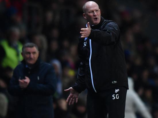 Bradford boss Simon Grayson considers his options ahead of Portsmouth clash
