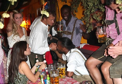 Drogba takes a break from Chelsea to pull on a lederhosen with his old foe Lehmann at Oktoberfest