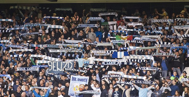 Platini to probe alleged racism by Lazio fans aimed at Spurs stars Lennon and Defoe