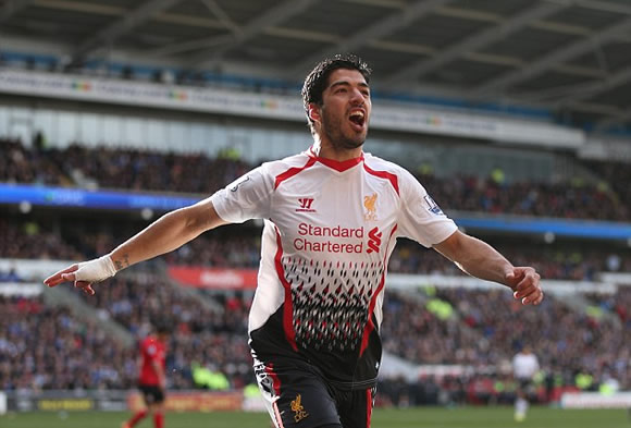 Family matters: Suarez relaxes with his wife and children ahead of Sunderland clash