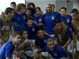 Quality! Brazil squad take a picture with handicapped child before Cameroon match