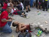 Costa Rica fans left lying in pools of blood at fan park