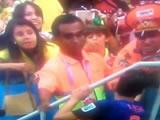 World Cup 2014: Robin van Persie appears to give his bronze medal to eccentric Netherlands fan moments after being handed it by