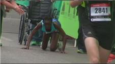 Ngetich crawls across the finish at the Austin Marathon