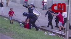 Benfica fan beaten by police in front of sons