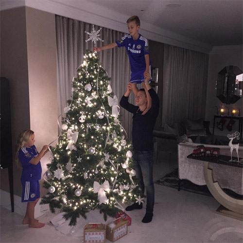 Chelsea captain John Terry puts finishing touches to Christmas tree