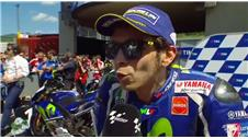 Home hero Rossi takes pole