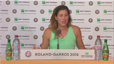 Muguruza brushes aside Wickmayer to ease into third round