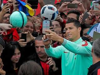 ME MYSELFIE AND I Euro 2016: Cristiano Ronaldo poses for selfies with Portugal fans as he forgets microphone mishap ahead of semi-final against Wales