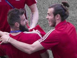 DRAGON PLAY Wales players laugh and joke in utterly relaxed walk around the Lyon pitch ahead of Euro 2016 semi-final with Portugal