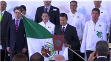 President of Mexico hands Mexican flag to Olympic athletes