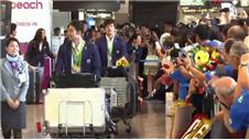 Japan swimming team return home