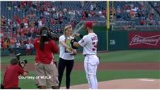 Olympic swimmer Ledecky throws ceremonial first pitch