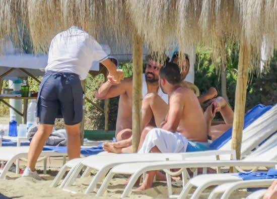 Diego Costa ALREADY taking break from Atletico Madrid training as he sips beer on a Marbella beach with pals
