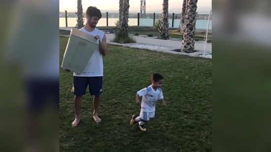 Isco playing with his son