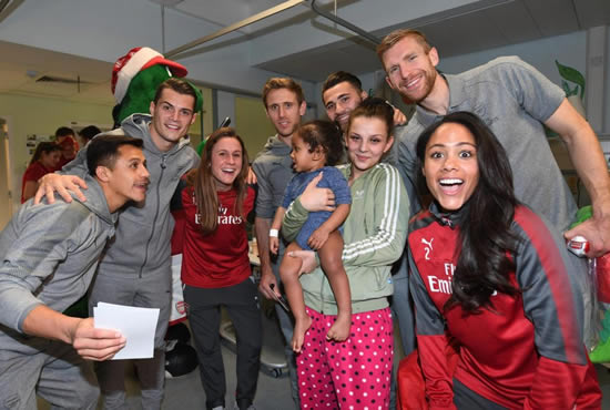 Host of Arsenal stars including Alexis Sanchez, Mesut Ozil and Granit Xhaka spread Christmas cheer to sick children at local hospitals