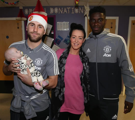 Manchester United stars Paul Pogba and Zlatan Ibrahimovic make heartwarming Christmas trip to hospital to visit poorly kids