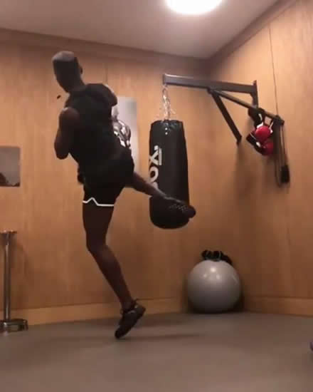 Manchester United star Paul Pogba shows off kung fu kick as he battles Zlatan Ibrahimovic to see who can get leg higher