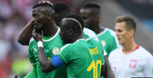 Poland 1 Senegal 2: Good fortune and bad errors hand Africans Group H win