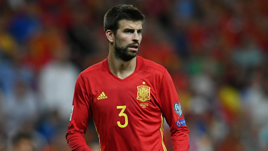 Pique confirms retirement from Spain national team to focus on Barcelona